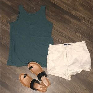 Teal blue tank top. Tulip cut back. Size small